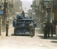 Egyptian police patrol the streets of Abu Tig, a village south of Assiut, after a curfew was imposed, following the killing of two police officers. 14th of April 1993. Ph. Norbert Schiller