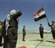 PLO Leader Yasser Arafat saluting the Egyptian flag at the border town of Rafaa just prior to his historic homecoming to Palestinian territory. 1st of July 1994. Ph. Norbert Schiller