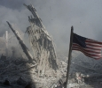 An American flag flies near the base of the destroyed World TradeCenter in New York, in this file photo from September 11, 2001, takenafter the collapse of the towers. This year's anniversary of theSeptember 11 attacks in New York and Washington will echo the firstone, with silence for the moments the planes struck and when thebuildings fell, and the reading of 2,792 victims' names. REUTERS/Peter Morgan