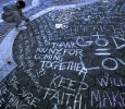 USA. New York City. September 15, 2001. Signing a memorial in Union Square. MAGNUM/Susan Meiselas