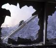 USA. New York City. 2001. Firefighter seen through blown out windows of the World Financial Center. MAGNUM/Steve Mc Curry
