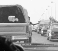 An Egyptian policeman waves his gun to in order to clear traffic away from a convoy of Israeli diplomats and government negotiators on 20 March 1986. Israeli and Egyptian officials are trying to settle the disputed stretch of land located at the very north of the Gulf of Aqaba that borders the two countries. Israel has occupied the stretch of land since the 1967 war. Ph. Norbert Schiller