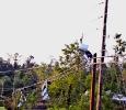 Scraps of metal hang from power lines, Alabama, May 2011. Ph. Amanda Dunn