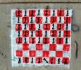 The Chess by El Teneen. Scacchiera in cui la pedina caduta è il Re. Piazza Tahrir, Il Cairo, Egitto